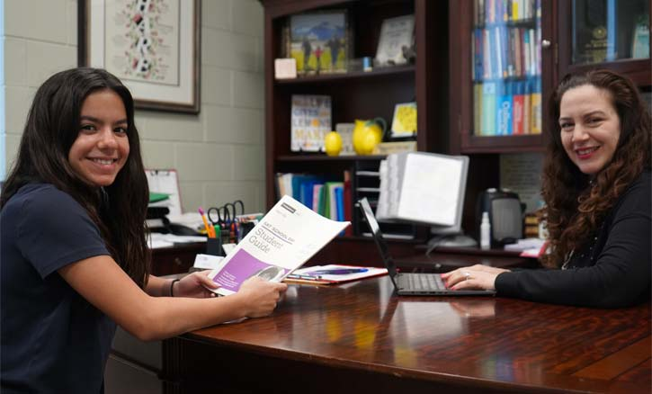 Yanira Palomo, guidance counselor at FLA, helps a student navigate the SAT